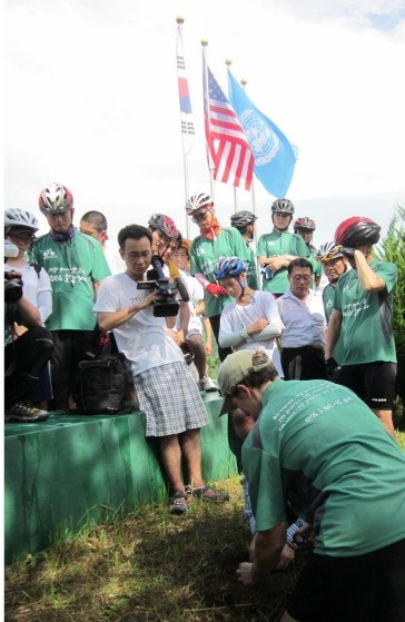U.S. Ambassador, Honorable Kathleen Stephens collects soil from the Pusan Area of the Republic of Korea