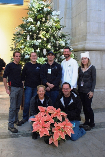Smithsonian Gardens staff posing with the National Museum of American History tree.