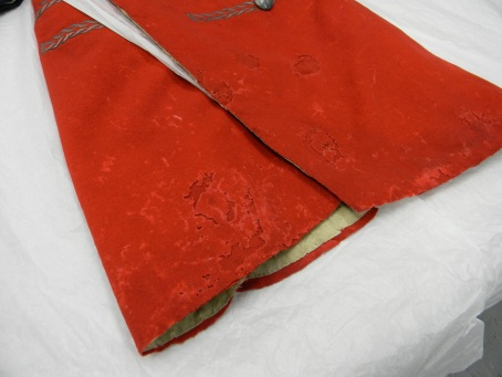Revolutionary War red wool coat damaged by carpet beetles