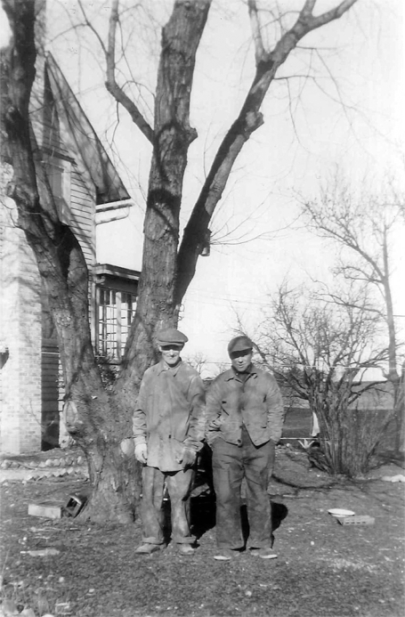 George Napientek outside cleaning up tree damage after a storm on his homestead