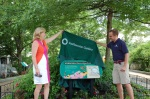 Unveiling of sign in front of Pollinator Garden